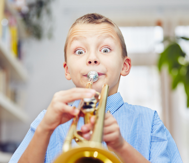 child playing trumpet